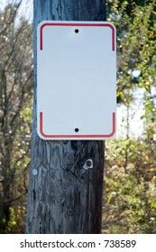 Blank Street Sign on a telephone pole- add your own text!  Focus on sign.