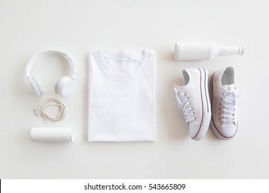 Blank stuff on white background. Template for design presentations. Branding Mock-Up. Shirt, sneakers, headphones, bottle.