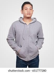 Blank sweatshirt mock up, front view. Asian male model wear plain gray hoodie mockup. Hoody design presentation. Jumper for print. Blank clothes sweat shirt sweater