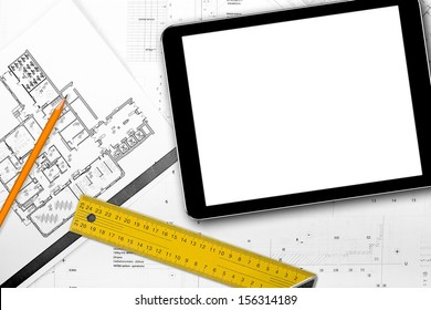 blank tablet and tools on house project blueprints