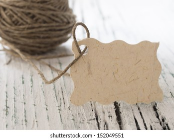 blank tag with string on the white table