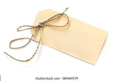 Blank tag tied with brown string, isolated on white, top view.  Price tag, gift tag, sale tag, address label, etc.