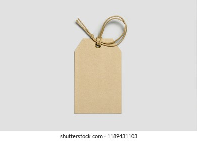 Blank tag tied for hang on product for show price or discount isolate on white background with clipping path. Price tags,Cardboard labels isolated on white.
