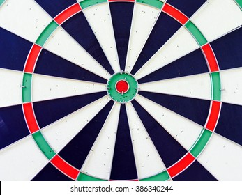 Blank target dartboard with no hits, abstract background.