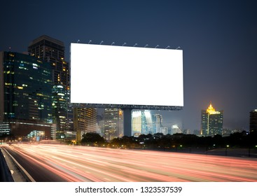 Blank template  for outdoor advertising or Blank billboard with a background of city. With clipping path on screen - can be used for trade shows, and advertising or promotional poster.