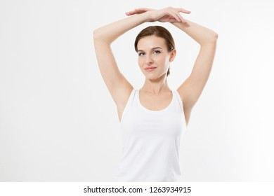 Blank template t shirt. Beauty Woman with perfect skin armpits and epilation isolated on white background. Laser hair removal. Brunette girl holding arms up and showing clean underarms. Copy space