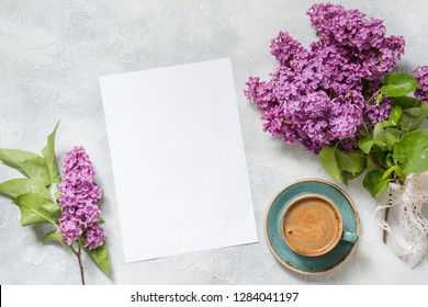 Blank for text, morning black coffee, and bouquet purple lilac. Top view. Spring. View from above.