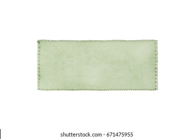Blank textile green clothes label isolated over white