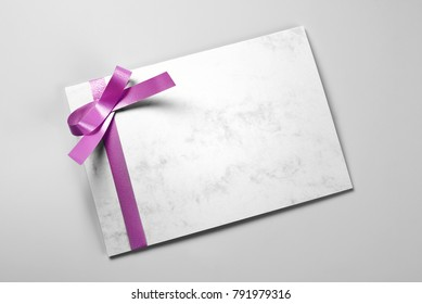 Blank thank you card decorated with violet ribbon