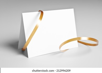 Blank  thank you or greeting card with golden ribbon