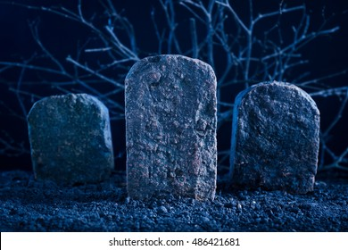 blank tombstone in the dark night at graveyard, halloween background