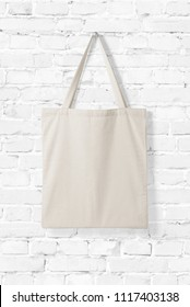 Blank Tote Canvas Bag Mockup on white brick wall background. High resolution.