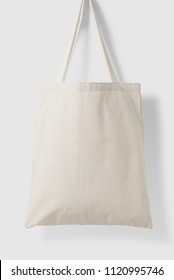 Blank Tote Canvas Bag Mockup on light grey background. High resolution.