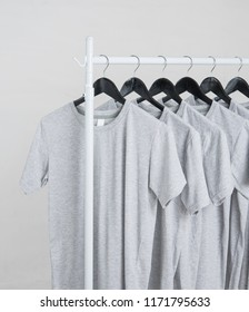 Blank T-Shirts Mock-up on hangers on gray background
