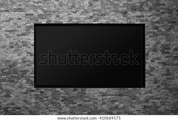 Blank tv on the brick wall with copy space