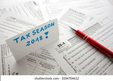 Blank USA fiscal documents and pen on desk, tax season 2018 reminder concept