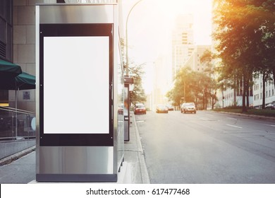 Blank vertical lightbox on the bus stop, Sunlights effects