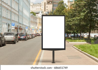 Blank vertical street billboard poster on city background. 3d illustration.