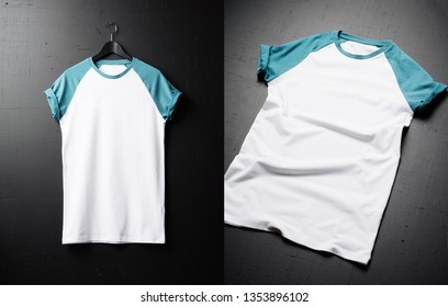 Blank vintage fold t-shirts on dark wooden surface background. Front view of American Hipsters vintage classic clothes