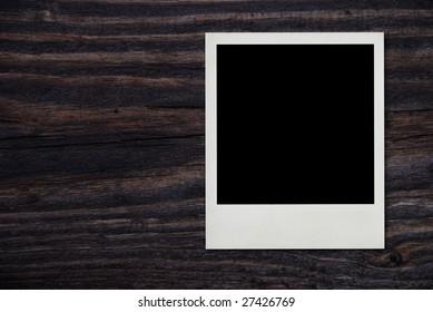 blank vintage photo frame on wood background