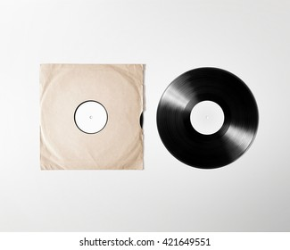 Blank vinyl album cover sleeve mockup, isolated, clipping path. Gramophone music plate clear surface mock up. Paper sound shellac disc label template. Vintage old grunge cardboard vinyl disk packaging