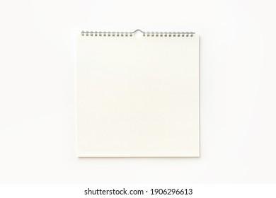 Blank wall calendar background on white.