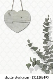 blank weathered wooden heart on wall with moroccan print wallpaper, with Eucalyptus cinerea, interior still life with copy space
