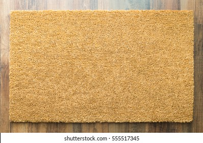 Blank Welcome Mat On Wood Floor Background Ready For Your Own Text.