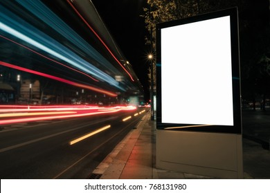 Blank white advertisement lightbox at night. Mock-up design concept. Car lights.