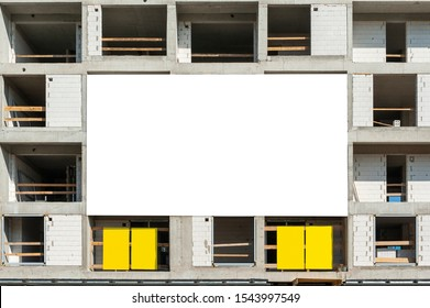 Blank white advertising banner mockup on the building under construction