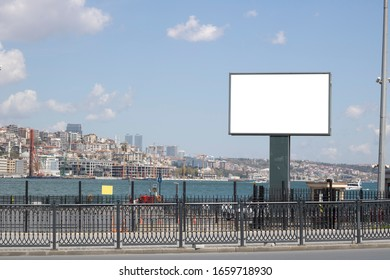 Blank white advertising sign close-up. In the background, the Bosphorus passes in the foreground. Photographed in Istanbul.