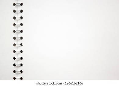 blank white album paper sheet with spiral binding texture