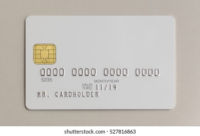Blank white bank credit card on paper background