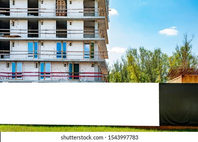 Blank white banner for advertisement on the fence of construction site