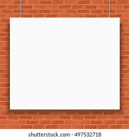Blank white banner hanging in front of brick wall
