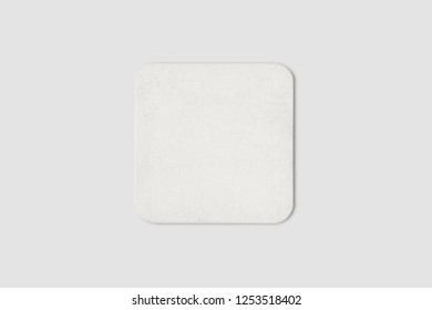 Blank white beer coaster mockup, top view, lying on white background. Squared clear can mat design mock up isolated.High resolution photo.