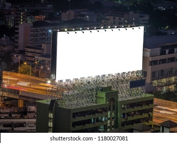 blank white bilboard on tower and on dark city background