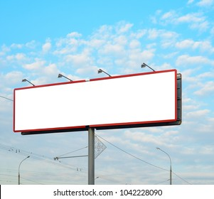 Blank white billboard on background with cloudy sky, mockup