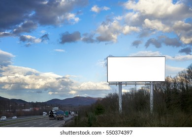 Blank white billboard on blue sky with the highway