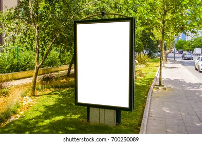 Blank white billboard on the street on a sunny day