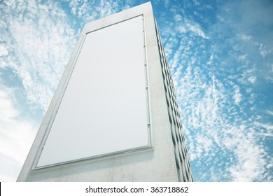Blank white billboard on the wall of high building with blue sky, mock up