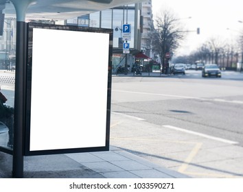 Blank white billboard sign at a bus stop in a city