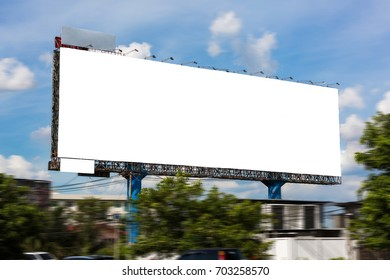 Blank white billboard under blue sky - can advertisement for display or montage input the free space of product and business.
