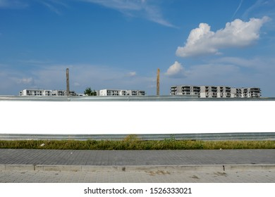 Blank white billboard/banner for advertisement on the fence of construction site