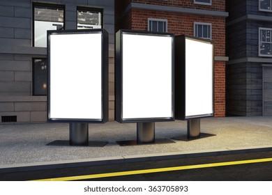Blank white billboards on evening city street, mock up