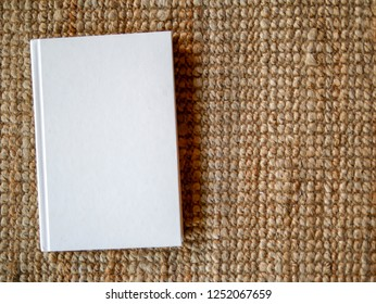 Blank white book cover on mat texture copy space by composition