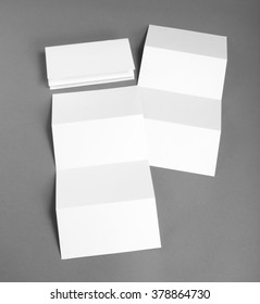 Blank white booklet on gray background