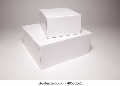 Blank White Box Isolated on a Grey Background Ready for Your Own Graphics.