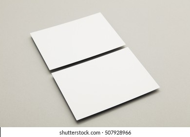 Blank white business card postcard flyer on a grey background