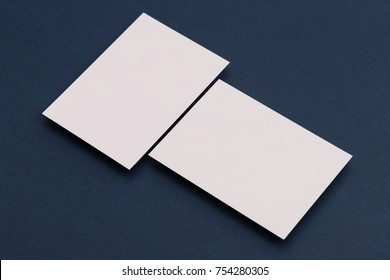 Blank white business card postcard flyer on a blue background